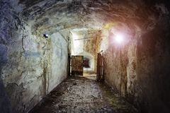 Dark and creepy corridor of old abandoned forgotten Soviet underground bunker royalty free stock image