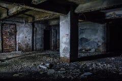Dark and creepy dirty abandoned underground basement.  royalty free stock photo