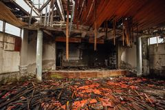 Dark creepy interior ruined collapsed abandoned stage or cinema theater.  stock photo