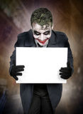Dark creepy joker face Stock Photo