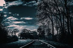 A dark and creepy railroad track. This will be good for horror, and creepy projects. stock photos