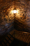 Dark creepy stairwell. A dimly lit stairwell curls into the darkness Royalty Free Stock Photos