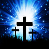 Dark cross against a blue Stock Photo
