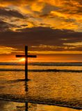 The Black Cross Sunset Beach. Dark cross on a beach with a wonderful sunset sky Royalty Free Stock Photo