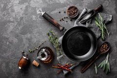 Dark culinary background with empty black pan. And space for text recipe or menu stock photography