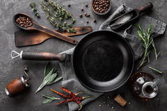 Dark culinary background with empty black pan. And space for text recipe or menu Stock Images