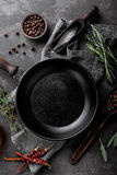 Dark culinary background with empty black pan Royalty Free Stock Photos
