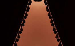 Dark curtains or drapes in theater Stock Photos
