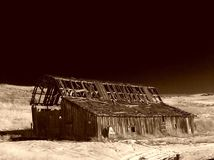 Dark Days. An old wood barn in the winter hills of Okanogan county in Washington state.  Done in Sepia tone Stock Image