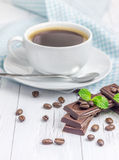 Dark delicious chocolate and coffee. Dark delicious chocolate with a cup of coffee Stock Photo