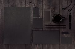 Dark deluxe black branding stationery, mockup scene with phone, coffee on black wooden plank. Dark deluxe black branding stationery, mockup scene with phone stock photography