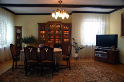Dark dinning room. In old style with clock in the corner royalty free stock photos