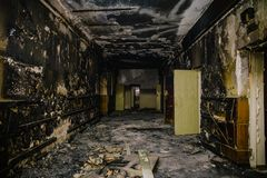 Dark dirty corridor in soot and ash, burnt-out abandoned building, fire consequences concept Stock Photography