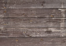 Dark dirty old boards of wood. Background Stock Photos