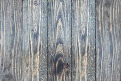 Dark distressed wooden texture backdrop. Distressed wooden texture background / backdrop. Image shot from top in overhead view stock photography