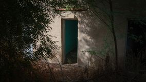 Dark door in Al Ain, Oasis, United Arab Emirates royalty free stock images