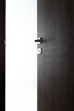 Dark door open e. Dark door open, with the handle, on white background royalty free stock photo