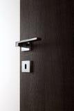 Dark door open g. Dark door open, with the handle, on white background royalty free stock photography