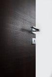 Dark door open j. Dark door open, with the handle, on white background royalty free stock images