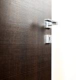 Dark door open l. Dark door open, with the handle, on white background royalty free stock photos