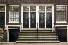 Dark doors of canal houses in Amsterdam Stock Images