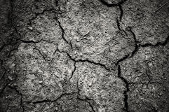 Dark dramatic of cracked soil with vignetting. Sad feeling Royalty Free Stock Photography