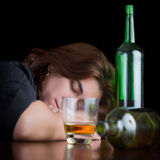 Dark dramatic image of a drunk and tired woman Royalty Free Stock Image