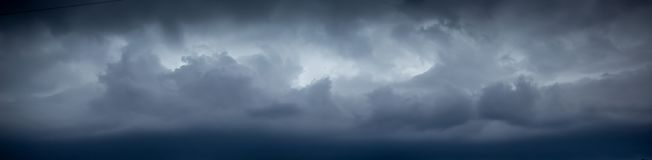 Dark dramatic stormy sky. Dark clouds in sky during hurricane. Panoramic image royalty free stock photography