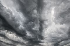 Dark dramatic stormy sky with grey heavy clouds. Perfect for wallpaper, wrapping, fabric, background, apparel, prints, banners Royalty Free Stock Images