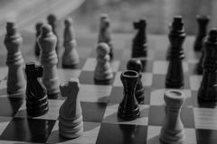 Dark and dreadful chess battle expecting to lose and suffer a bi. Tter defeat against the victor.  Copy space Royalty Free Stock Photos