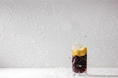 Dark drink drops glass beaker. Cold object Stock Images