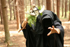 Dark druid casting spell Royalty Free Stock Photography