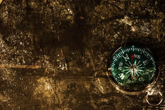 Dark edged paper and compass Royalty Free Stock Image
