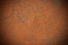 Dark edged rusty metal plate background Stock Image
