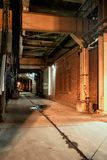 Dark and eerie city alley at night royalty free stock images