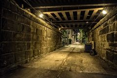 Dark and eerie urban city alley at night stock photos