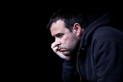 Dark emotions. A depressed man contemplating his future, shot on black Stock Images