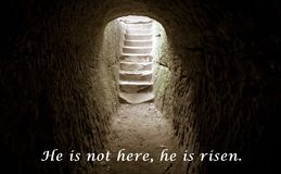 Empty Tomb Resurrection Jesus Background With Verse. Dark empty chamber with stone stairway encased in bright light with New Testament biblical scripture royalty free stock photography