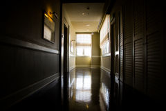 Dark and empty corridor with available natural light from window Stock Photos