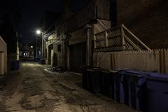 Dark empty and scary urban city street alley at night. Dark empty and scary urban city street Royalty Free Stock Image