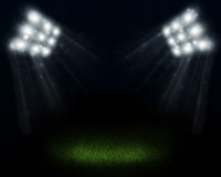 Dark empty stadium with bright spot Royalty Free Stock Photography
