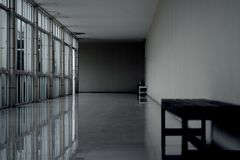 Dark empty walkway in building hall perspective with long white Stock Photos