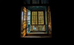 Dark environment, bright  window Stock Images