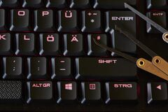 Free Dark Environment With An Illuminated Keyboard And Various Break-in Tools Symbolizing Cyber Crime Royalty Free Stock Photo - 217877435