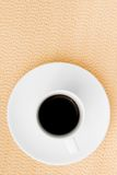 Dark espresso in a cup on burlap surface Stock Photos