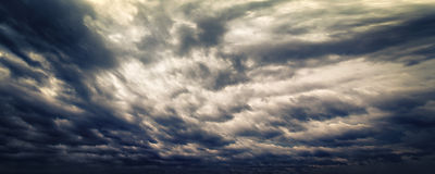 Dark evening stormy sky with light glimpses Royalty Free Stock Photos