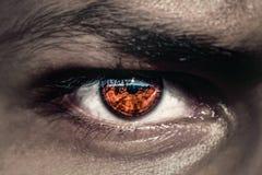 Free Dark Evil Eyes With Orange Pupil Stock Photography - 166407612