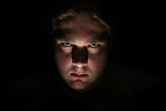 Dark evil face on black background Royalty Free Stock Photos