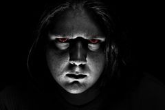 Dark evil face on black background Stock Photos