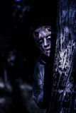 Dark evil zombie watching from horror forest Royalty Free Stock Image